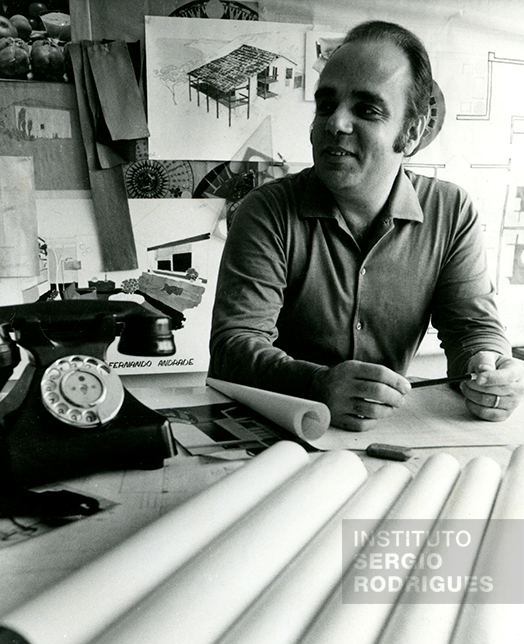 Sergio Rodrigues, at approximately age 43, in his office located at Rua No. 14 - store c, Ipanema - Rio de Janeiro, in the early 1970s.