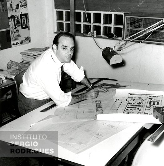 Sergio Rodrigues, at age 39, in his office at the Oca store, located at Rua Jangadeiros No. 14 - store c, Ipanema - Rio de Janeiro, in 1966.